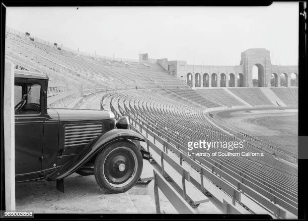 Cannonball delivery cars and man at Coliseum Los Angeles California 1930