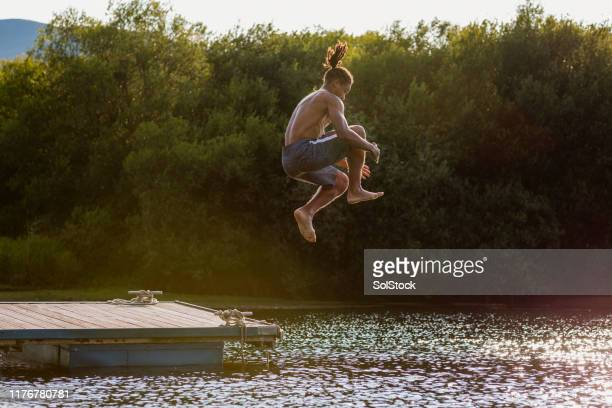 cannonball - jumping stock pictures, royalty-free photos & images