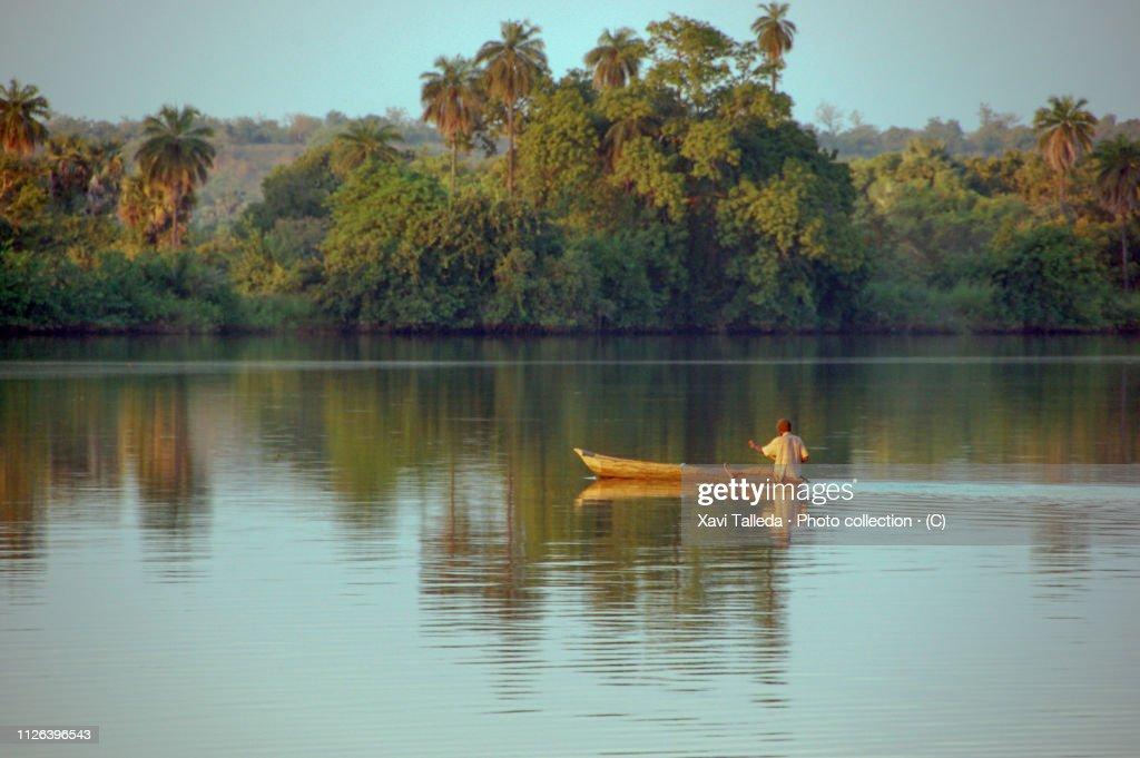 Canoe along the river : Stock Photo
