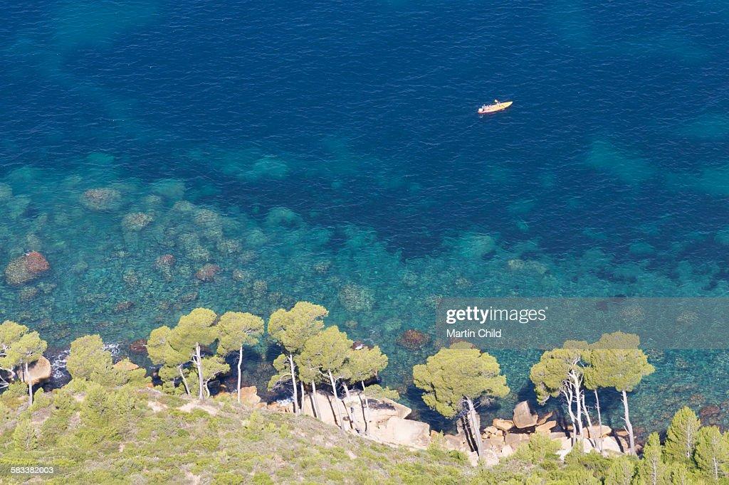 Canoe and coast near Cassis : Stock Photo