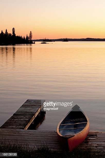 Canoe and Dock at Sunset