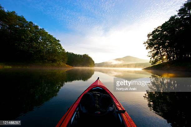 Canoe and lake in morning.