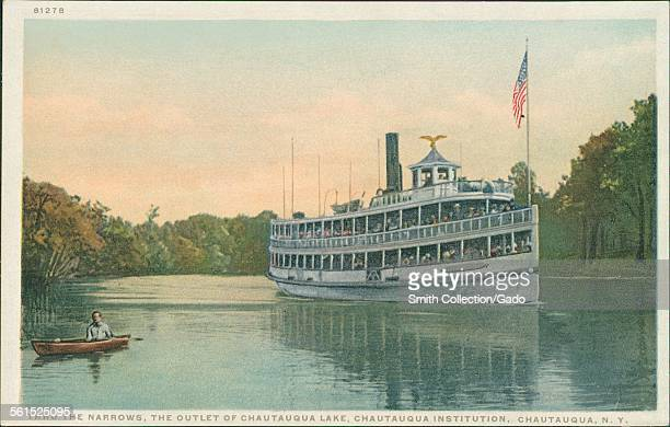 Canoe and steam boat with American flag in the narrows at the outlet of Chautauqua Lake Chautauqua New York 1922