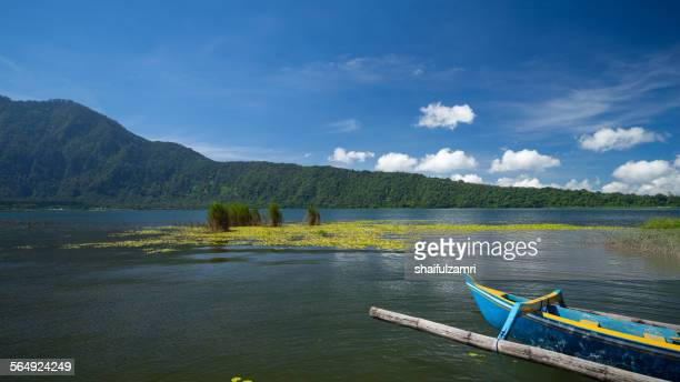 canoe at lake bratan - shaifulzamri stock pictures, royalty-free photos & images