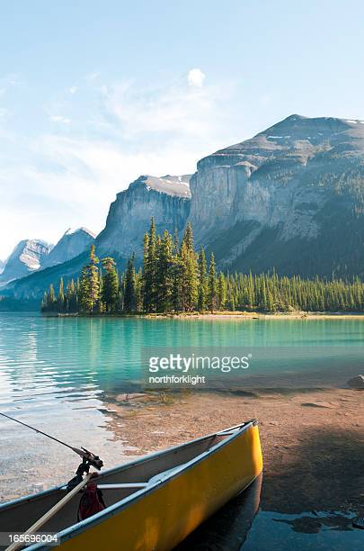 canoe at rest on maligne lake - columbia icefield stock pictures, royalty-free photos & images