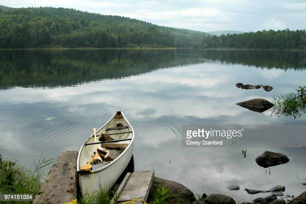 canoe docked at lakeshore, samuel de champlain provincial park, ontario, canada - lakeshore stock pictures, royalty-free photos & images