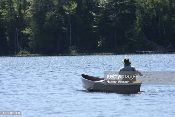 canoe fishing - recreational boat stock pictures, royalty-free photos & images