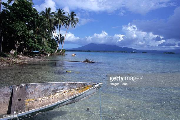 canoe moored on shore in roviana lagoon, solomon islands - solomon islands stock pictures, royalty-free photos & images