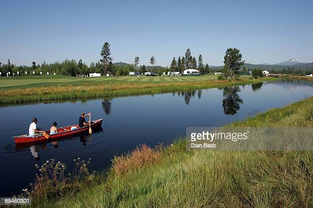 A canoe of visitors meander along the Little Deschutes River paddling past the ninth fairway during the third round of the JELDWEN Tradition held at...