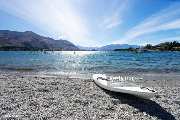 canoe on beach - lakeshore stock pictures, royalty-free photos & images