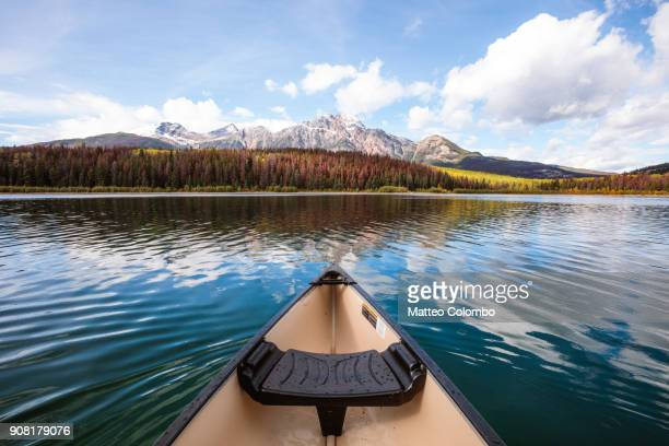 canoe on patricia lake, jasper national park, canada - canoe stock pictures, royalty-free photos & images