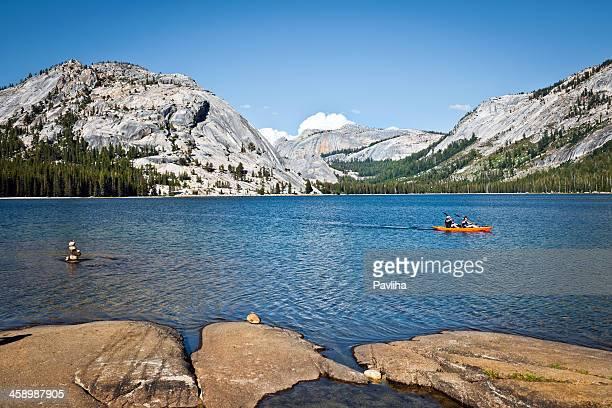 canoe on tenaya lake yosemite california usa - pavliha stock photos and pictures