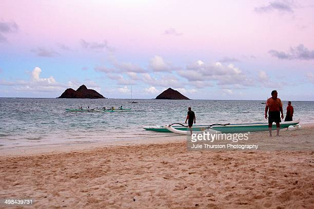 Canoe Paddlers Heading in at Sunset Under a Pink and Purple Sky With the Mokulua Islands at Lanikai Beach Oahu Hawaii