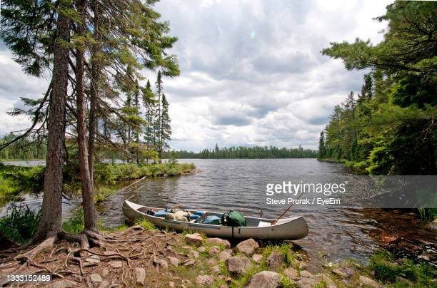 canoe ready to set off on sitka lake in the boundary waters - boundary waters canoe area stock pictures, royalty-free photos & images