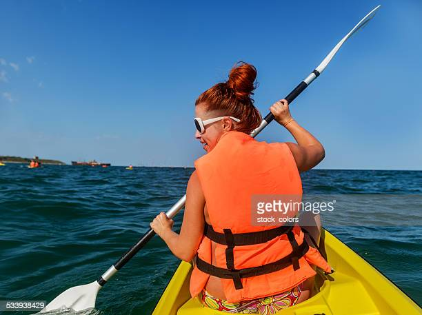 canoe woman - lake auburn stock photos and pictures