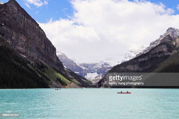 canoeing at lake louise - lake louise stock photos and pictures
