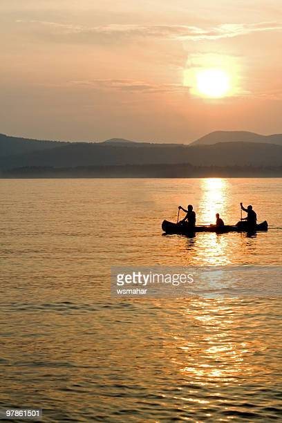canoeing at sunset - lake george new york stock pictures, royalty-free photos & images