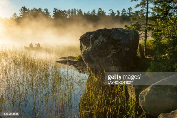 canoeing in minnesota's boundary waters canoe area wilderness (bwca) - boundary waters canoe area stock pictures, royalty-free photos & images