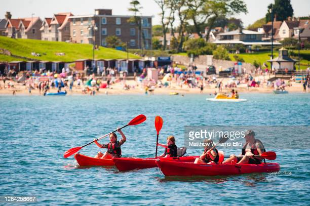 Canoeing in Swanage Harbor, Dorset, England, United Kingdom, Europe.