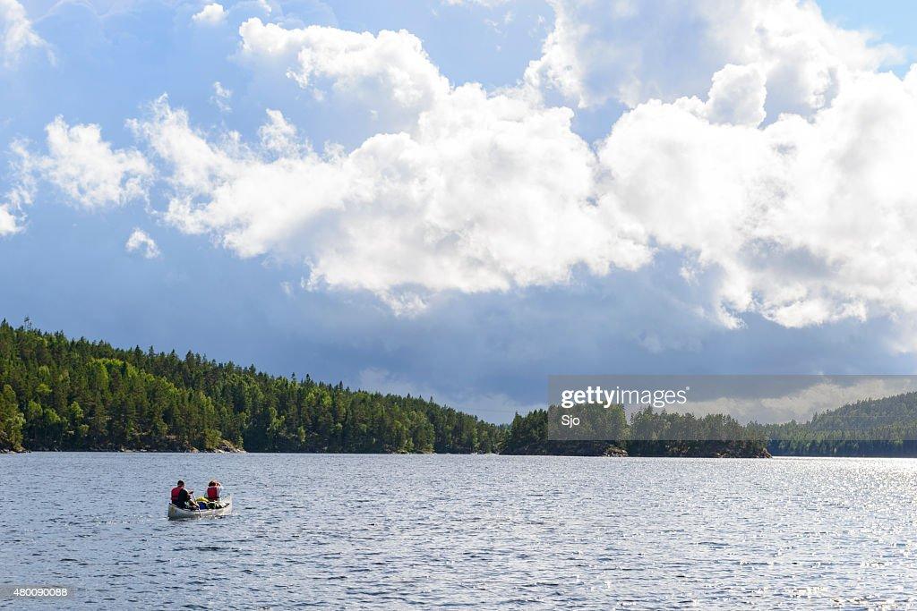 Canoeing in Sweden in summer : Stock Photo