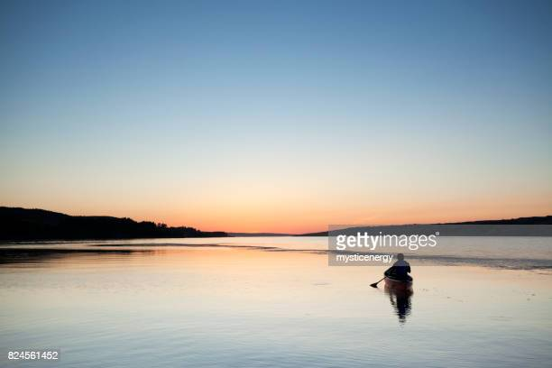 canoeing in to the sunset at buffalo pound provincial park saskatchewan canada - saskatchewan stock pictures, royalty-free photos & images