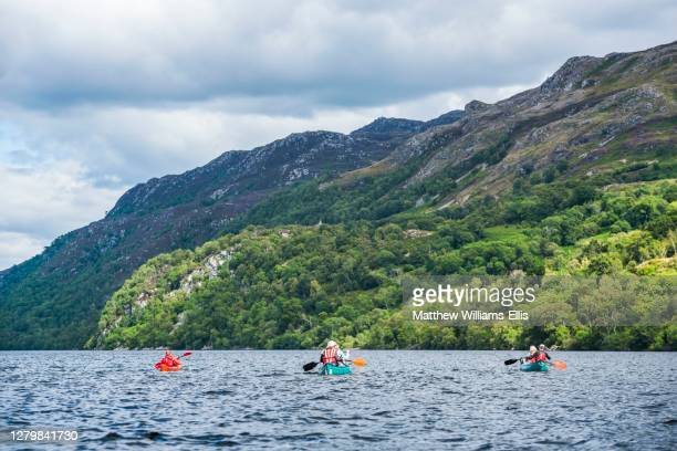 canoeing loch ness section of the caledonian canal, near fort augustus, scottish highlands, scotland, united kingdom, europe - loch ness stock pictures, royalty-free photos & images