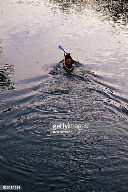 canoeing on a lake - lake solitude (new hampshire) stock photos and pictures