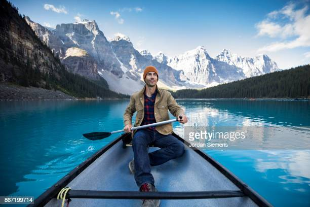 canoeing on a turquoise lake - image stock pictures, royalty-free photos & images