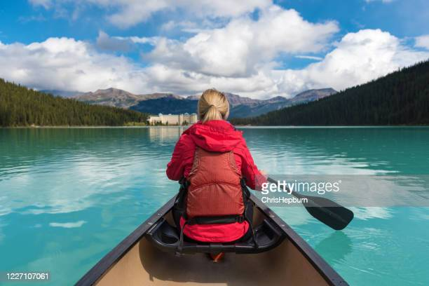 canoeing on lake louise, banff national park, alberta, canada - canadian rockies stock pictures, royalty-free photos & images
