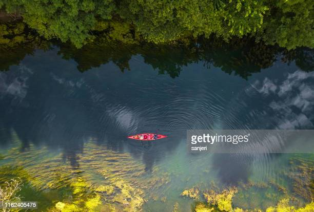 canoeing on the river - outdoor pursuit stock pictures, royalty-free photos & images