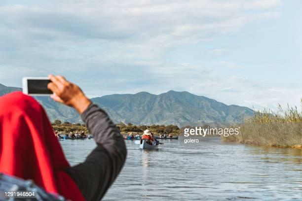 canoeing on the zambezi river in zambia - zambezi river stock pictures, royalty-free photos & images