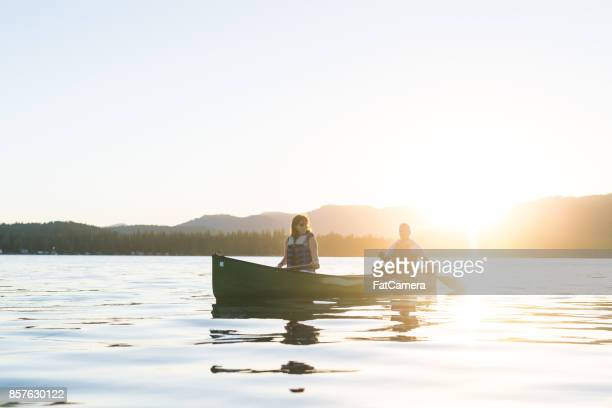 canoeing together on a beautiful lake - life jacket photos stock photos and pictures