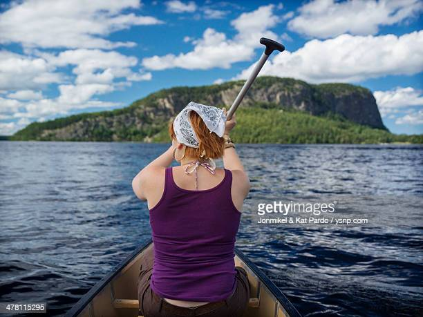 canoeing towards mount kineo on moosehead lake - moosehead lake stock photos and pictures
