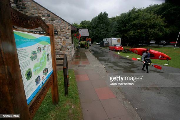 A canoeist makes his way towards the river at the Tryweryn white water rafting and canoeing centre at Bala north Wales It was discovered that two...