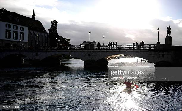A canoeist trains on river Limmat during sunrise on December 20 2014 in Zurich Switzerland The Swiss National Bank predicted consumer prices will...