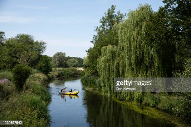 Canoeists meander down the Great Stour on June 26, 2020 in Fordwich, United Kingdom. The UK is experiencing a summer heatwave, with temperatures in...