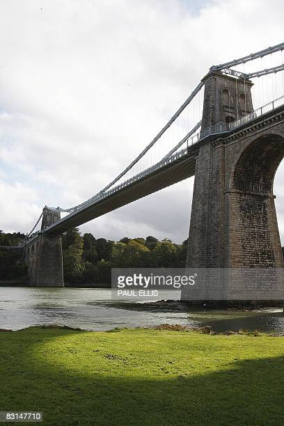 Canoeists paddle under the Menai Suspension Bridge in Anglesey Wales on October 6 2008 The bridge which crosses the Menai Strait between the island...
