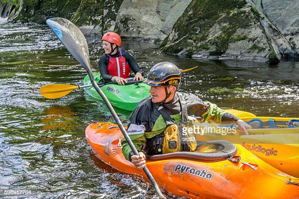 Canoeists riding the rapids
