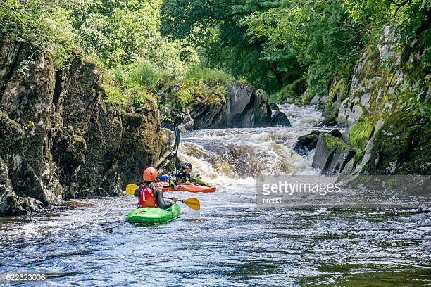 Canoeists riding the rapids