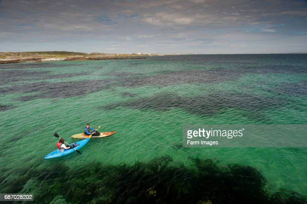 Canoeists take to the sea at Hynish Isle of Tiree Scotland