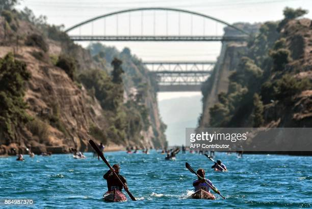 CanoeKayak athletes pass the 64 kilometres long Corinth canal separating the Peloponnese from the Greek mainland on October 22 2017 Some 300 athletes...