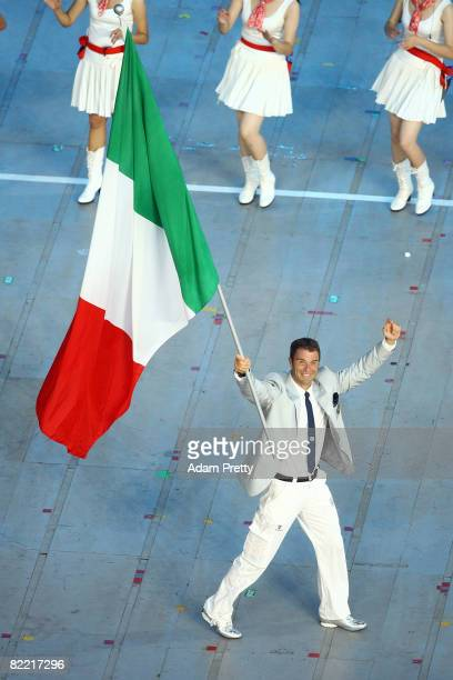 Canoe/Kayaker Antonio Rossi of Italy carries his country's flag during during the Opening Ceremony for the 2008 Beijing Summer Olympics at the...