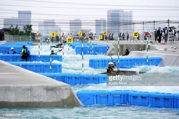 Canoers paddle in demonstration during the opening ceremony for the Kasai Canoe Slalom Centre in Tokyo the venue for the 2020 Tokyo Olympics on July...