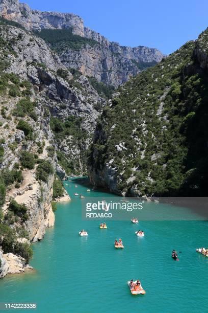Canoes and pedalos on the River Verdon in the Grand Canyon du Verdon near Lac de Ste Croix. In the Alpes de Haute Provence. Provence. France. Europe.