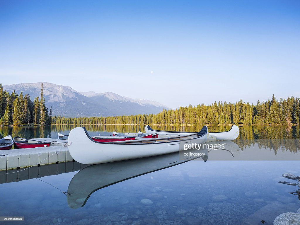 Canoes at Mountain Lake-Tranquil Scene : Stock Photo