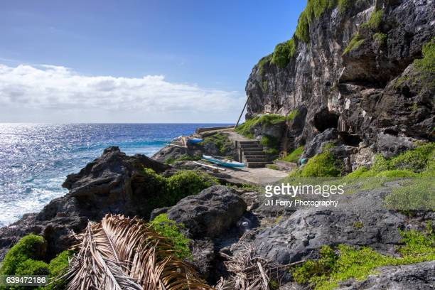 canoes by the sea - niue island stock photos and pictures