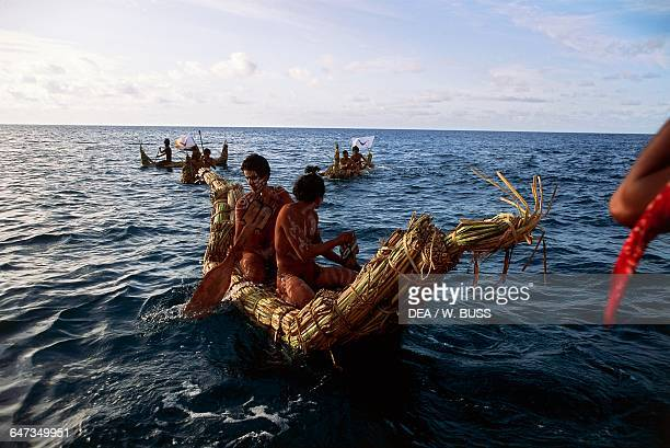Canoes during the Tau'a competition similar to the triathlon Tapati religious holiday Easter island or Rapa Nui