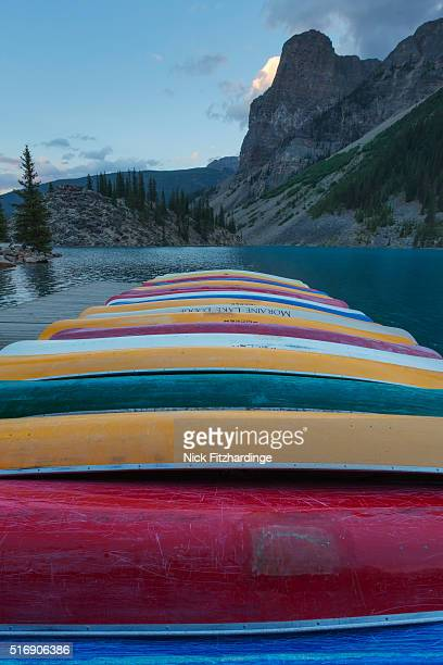 canoes lined up on moraine lake dock, banff national park, alberta, canada - tower of babel stock photos and pictures