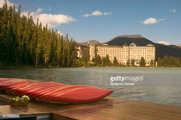 canoes near chateau lake louise - chateau lake louise stock pictures, royalty-free photos & images