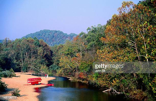 canoes on bank of jack's fork river, ozarks national scenic riverways. - ozark mountains stock pictures, royalty-free photos & images